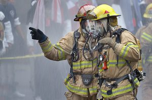 First responders firemen in gas masks